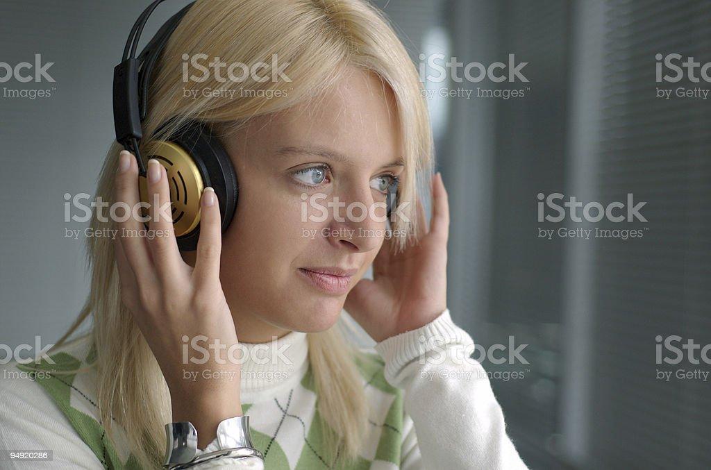Blondie with headphones royalty-free stock photo