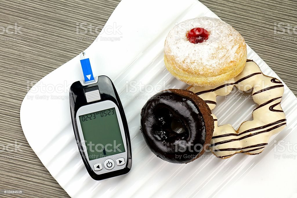Blood glucose meter test kit, Unhealthy food high sugar stock photo