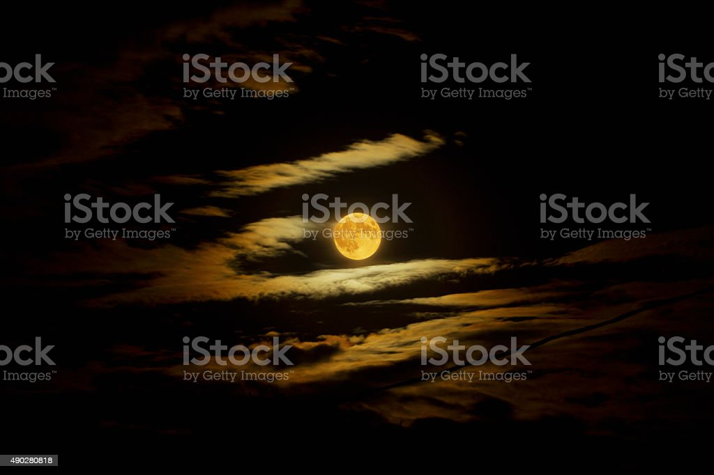 Blood Moon Through The Clouds stock photo