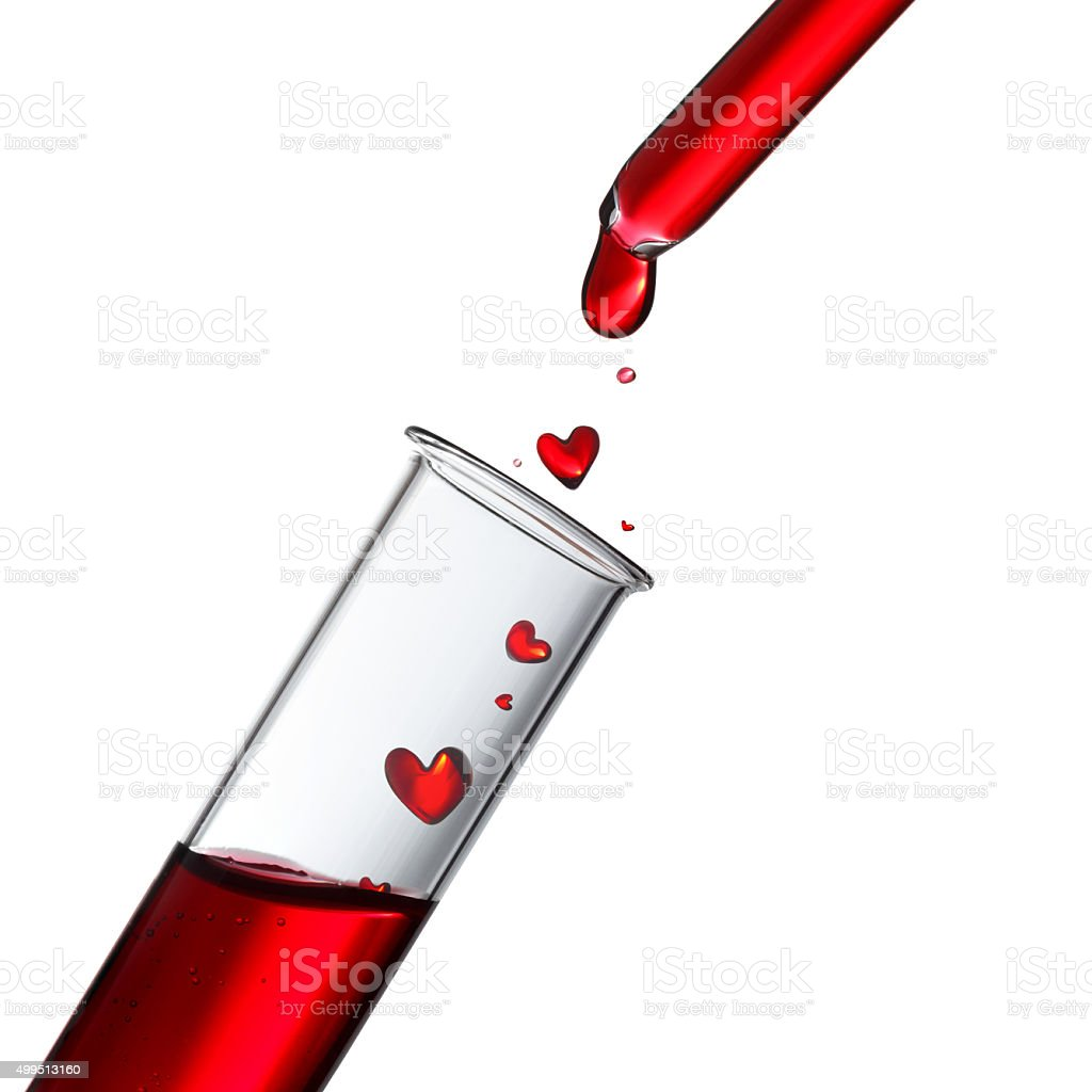 Blood or love potion drops in heart shape stock photo