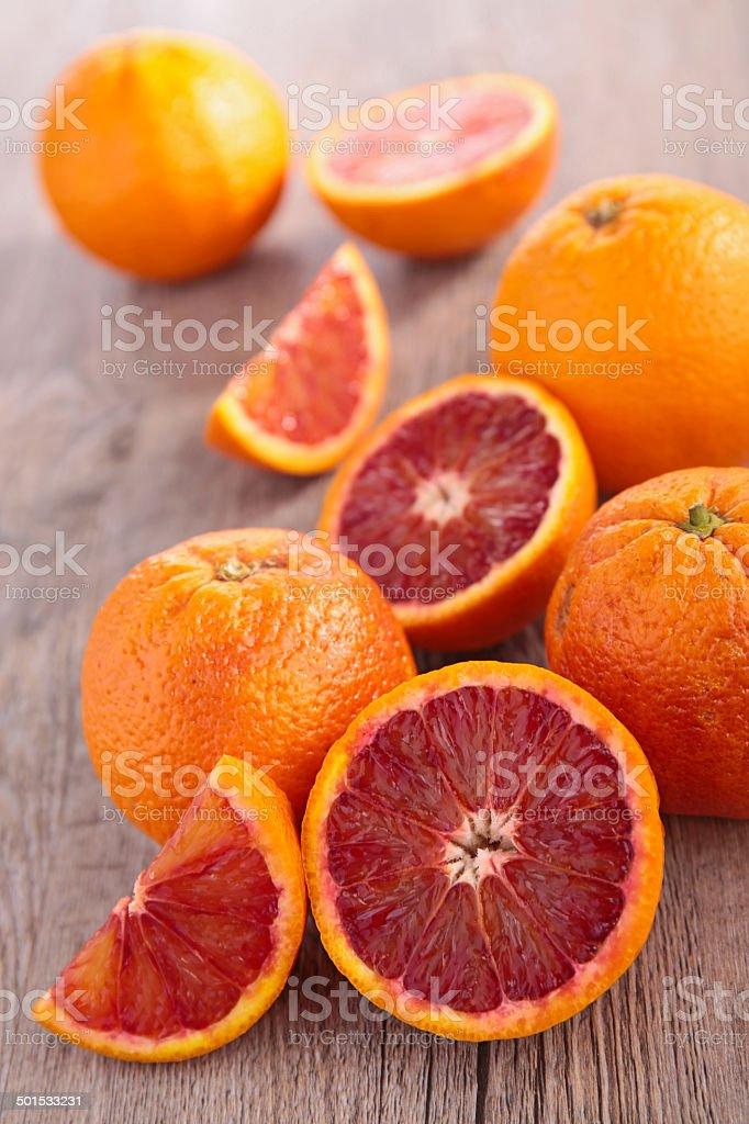 blood orange on wood stock photo