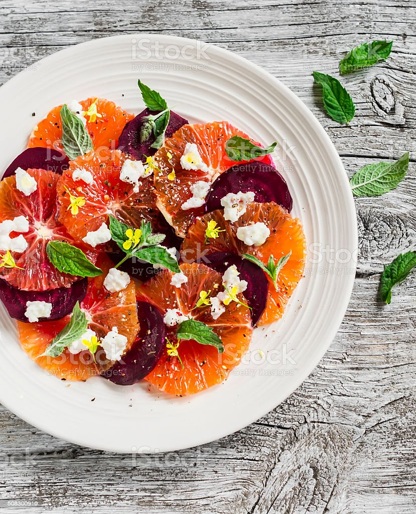 Blood oranges and beet salad with feta, mint and balsamic dressing stock photo