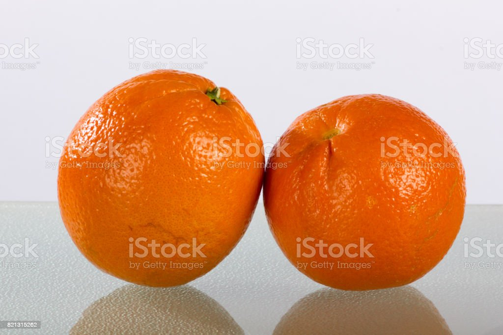 Blood Oranges Leaning Together with Reflection stock photo
