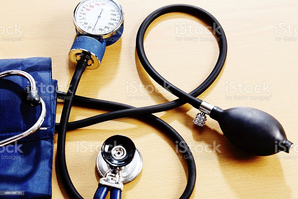 Blood pressure gauge and stethoscope ready to perform medical exam stock photo
