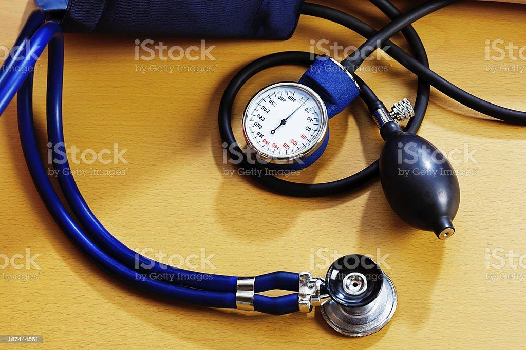 Blood pressure gauge on wooden desk stock photo