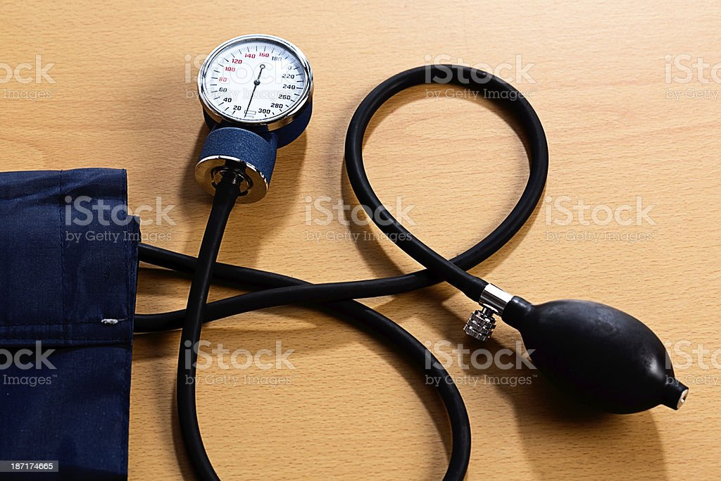 Blood pressure gauge on wooden surface stock photo
