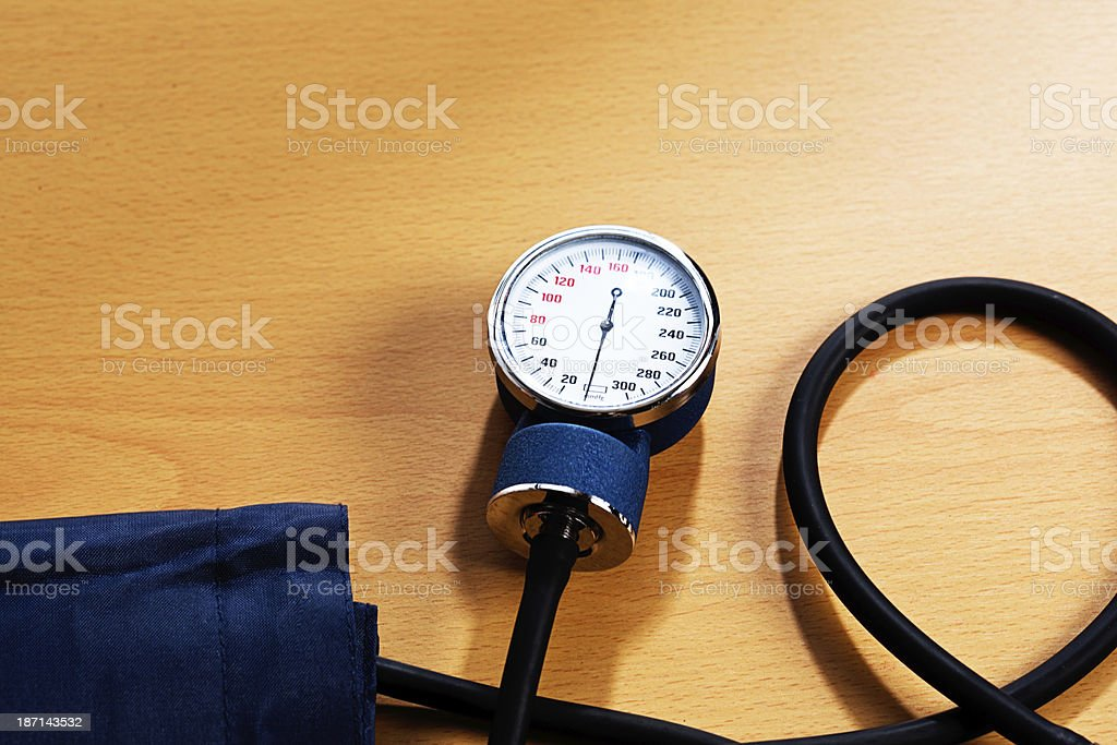Blood pressure measuring equipment on wood royalty-free stock photo