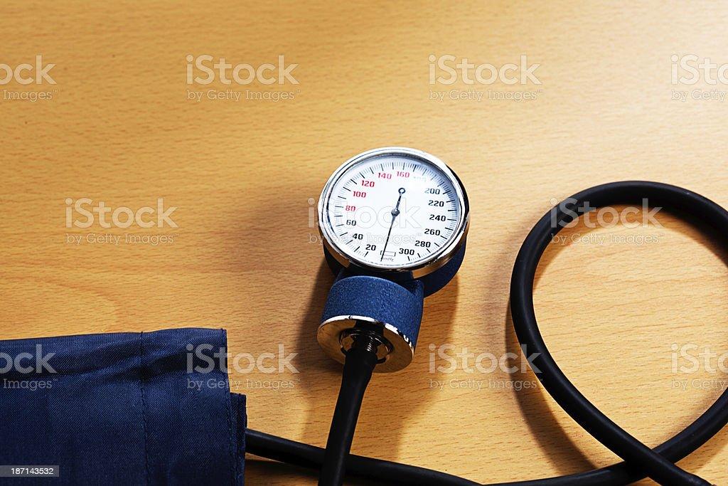 Blood pressure measuring equipment on wood stock photo