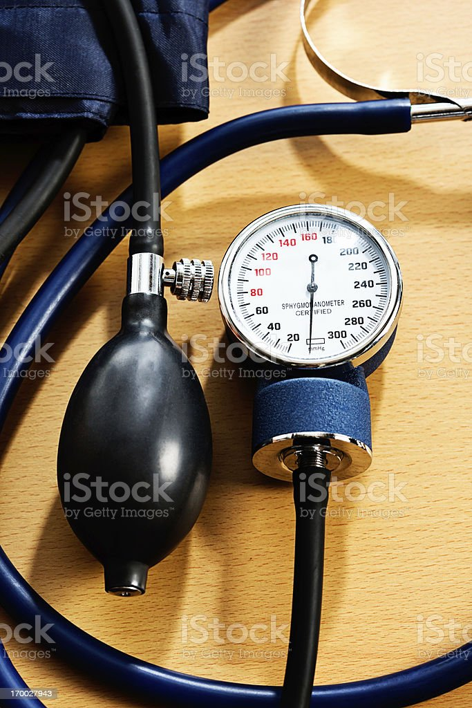 Blood pressure measuring equipment on wooden desk stock photo