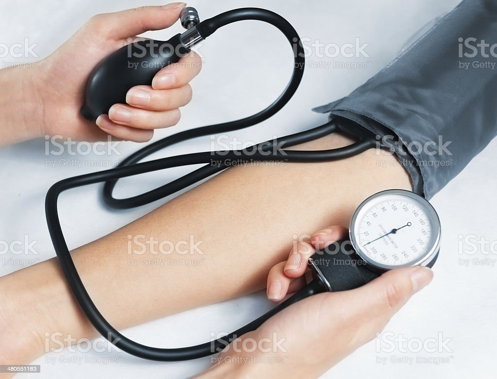 Blood pressure measuring on white background stock photo