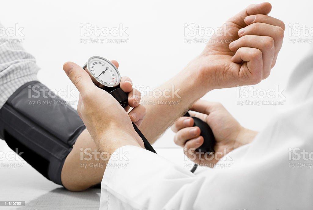 Blood pressure measuring studio shot stock photo