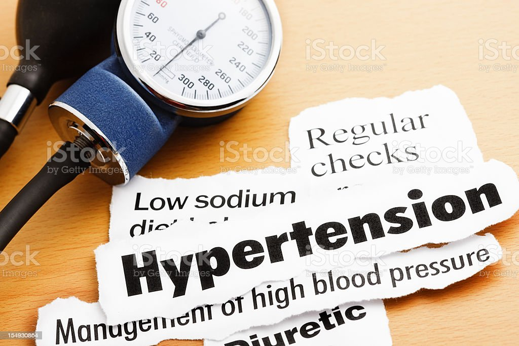 Blood pressure meter with headlines about hypertension stock photo