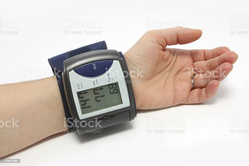 Blood pressure monitor on a wrist royalty-free stock photo