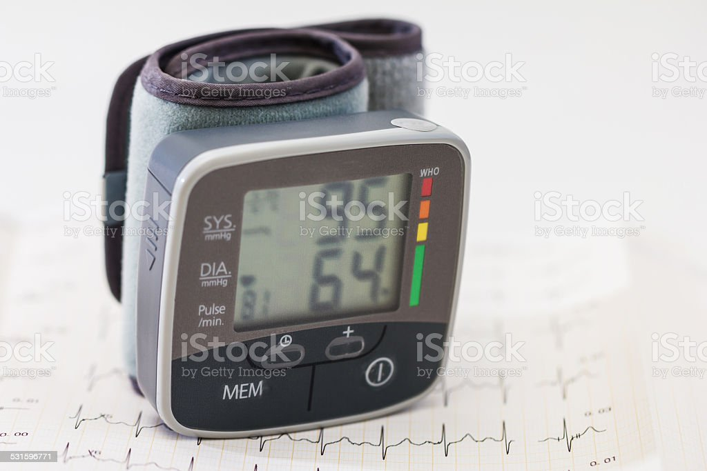 Blood pressure with cardiogram background stock photo