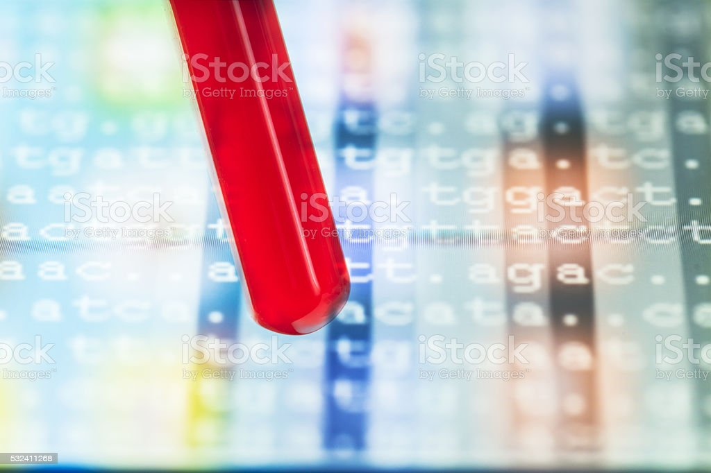 blood sample in test tube with DNA code stock photo