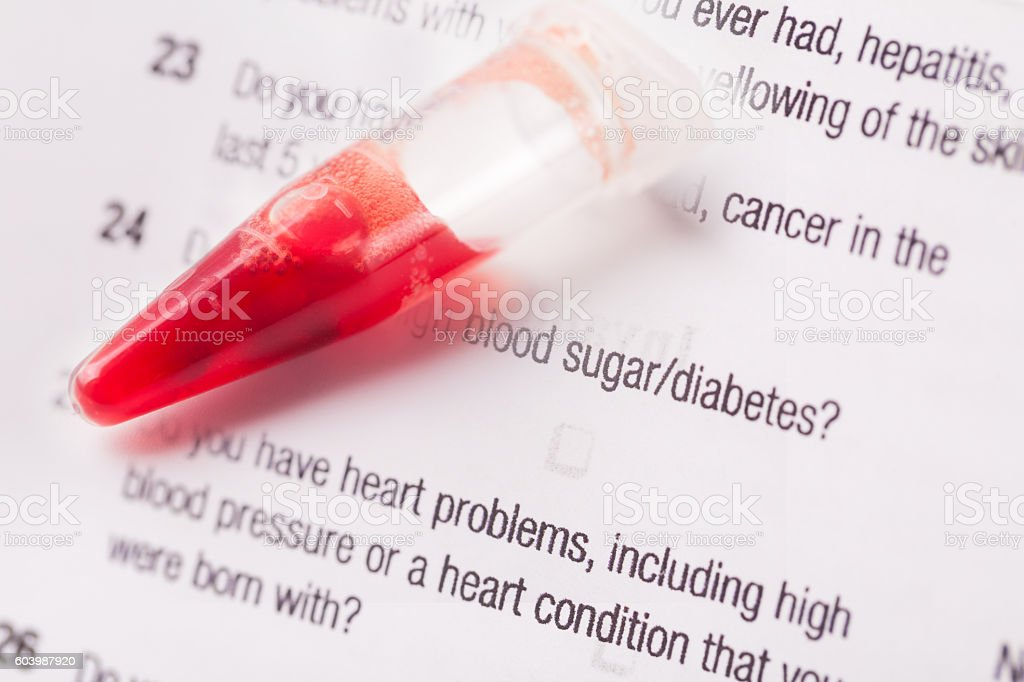 blood sample on tubes on medical exam form stock photo