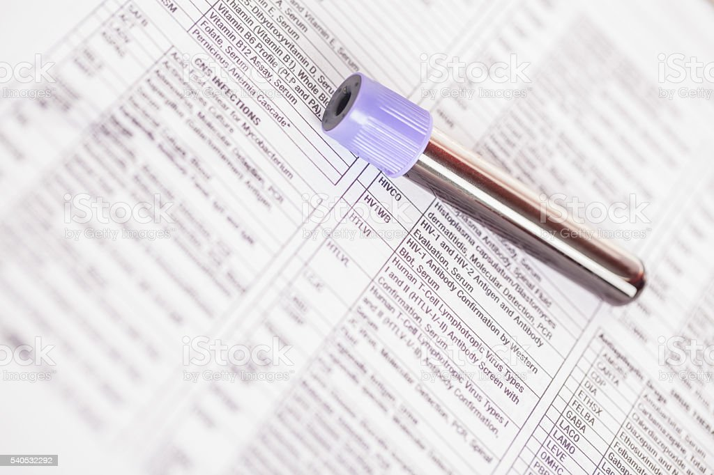 blood sample on tubes on medical exam forms stock photo
