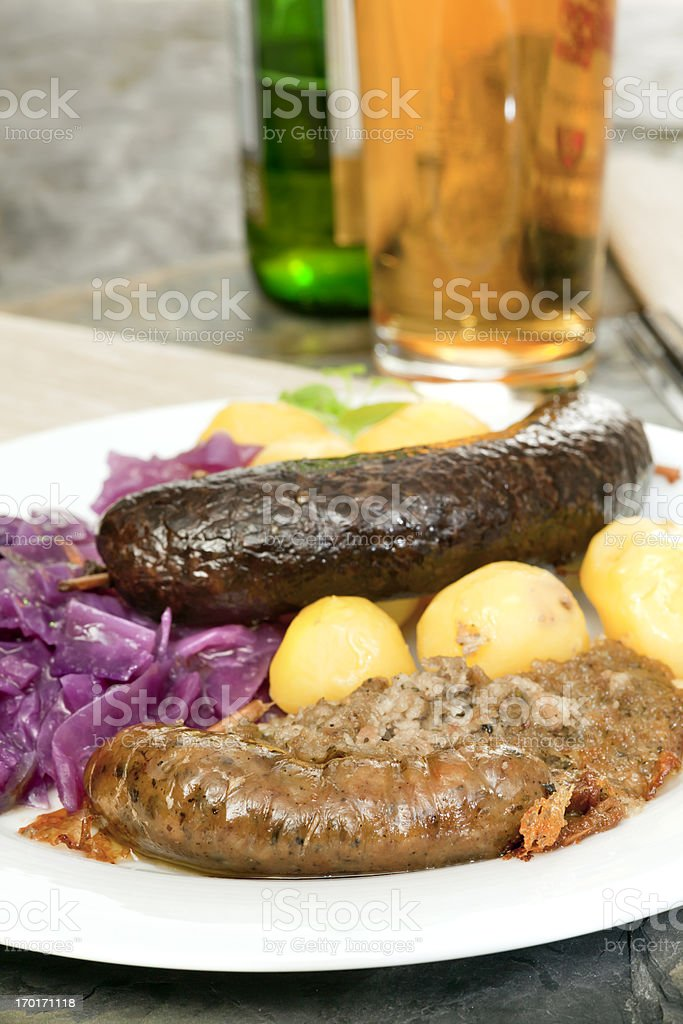 Blood sausage, white pudding, red cabbage and potatoes stock photo