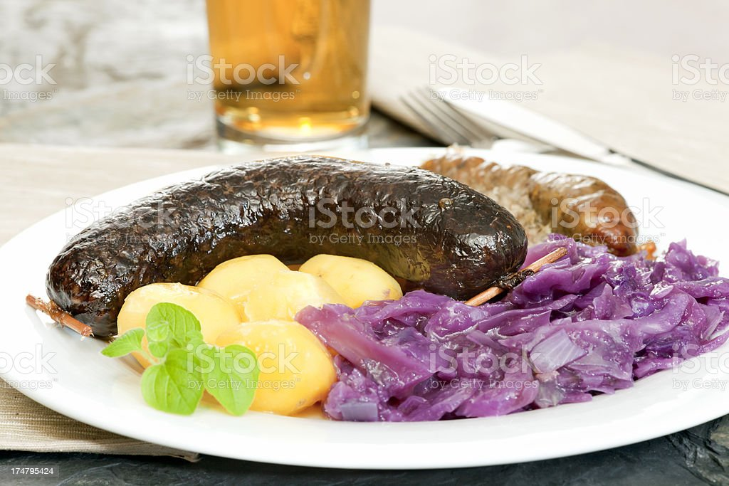 Blood sausage, white pudding, red cabbage and potatoes royalty-free stock photo