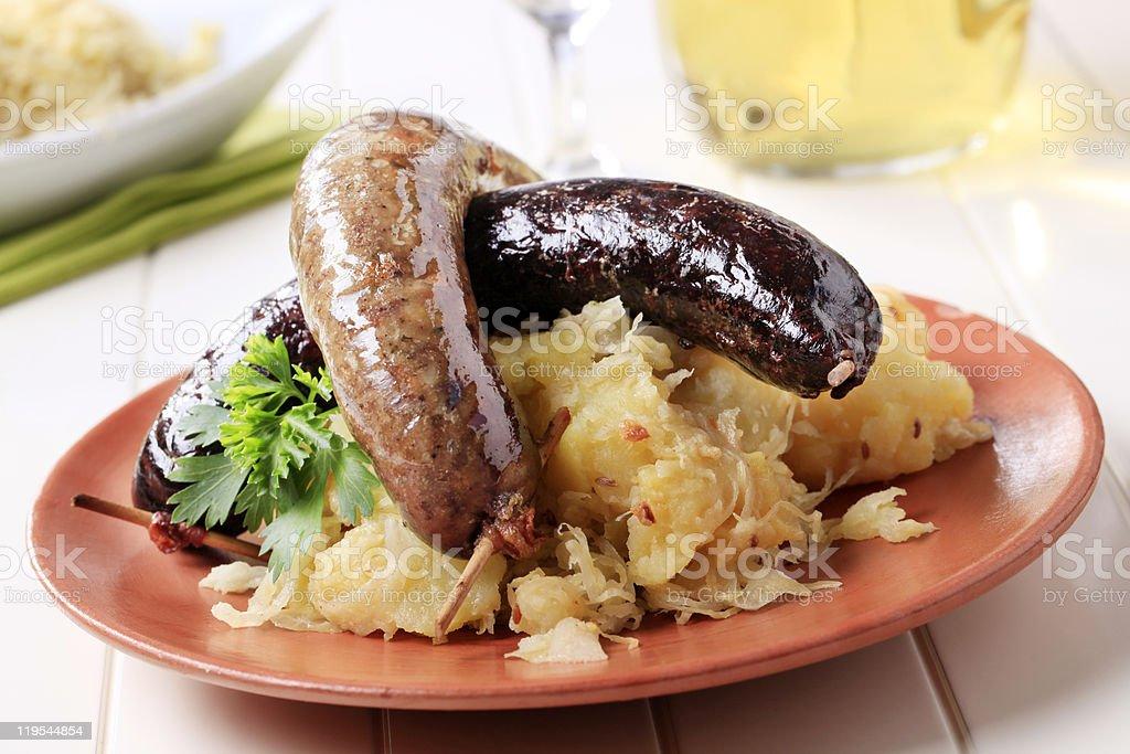 Blood sausage, white pudding, sauerkraut and potatoes royalty-free stock photo