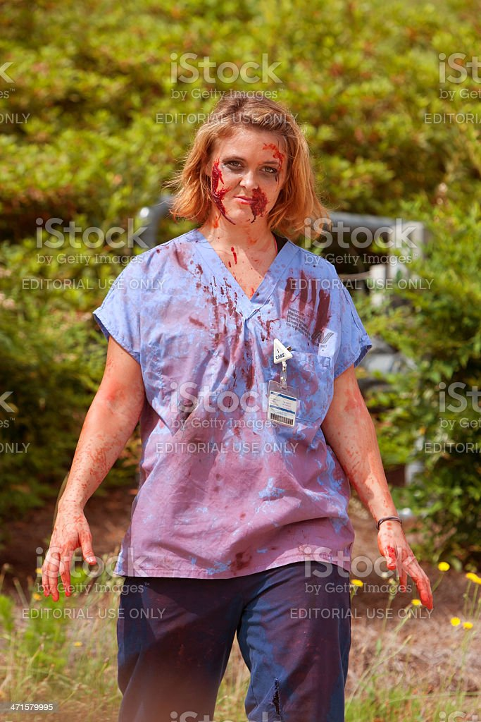 Blood Soaked Zombie Nurse Wanders Aimlessly At 5K Race stock photo