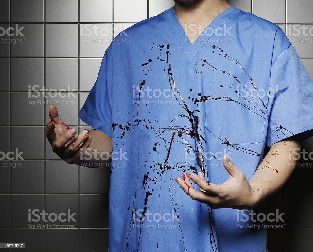 Blood Spilled on Doctor's Coat stock photo