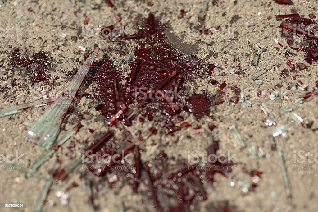 Blood stain on the road stock photo