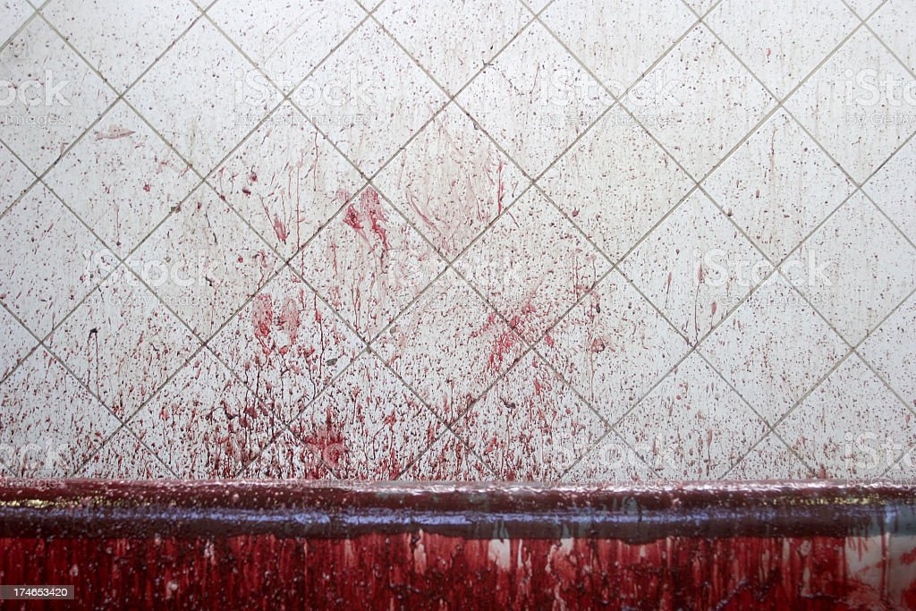 Blood staining on white tiled wall stock photo
