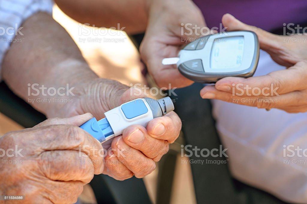 blood sugar measuring stock photo