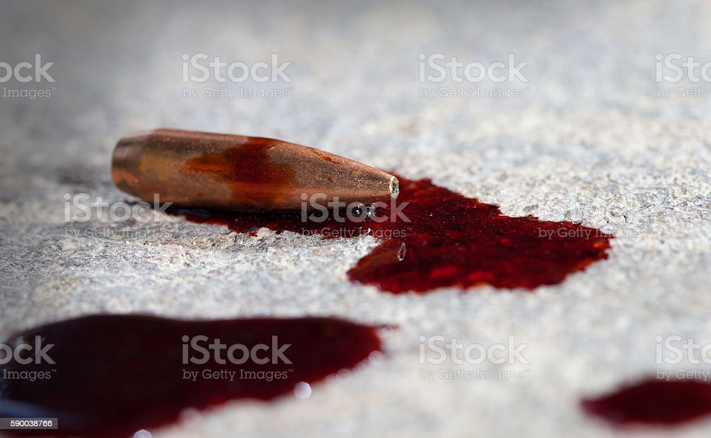 Bloody bullet stock photo