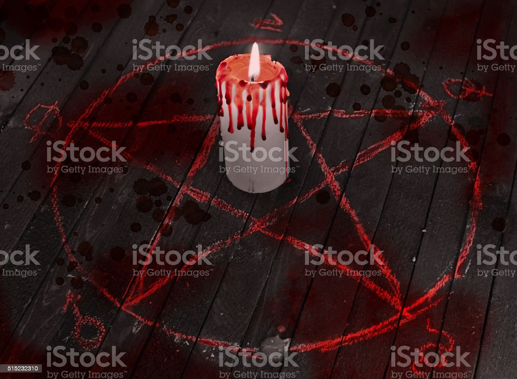 Bloody candle in pentagram circle stock photo