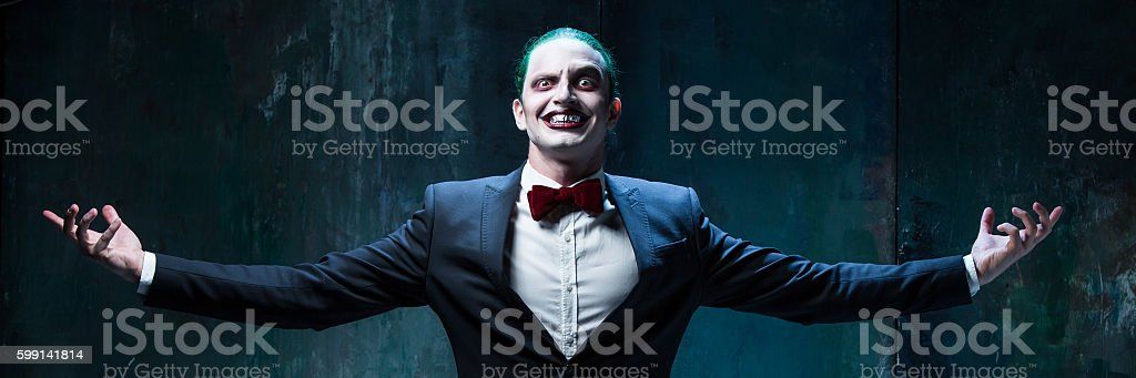 Bloody Halloween theme: crazy joker face stock photo