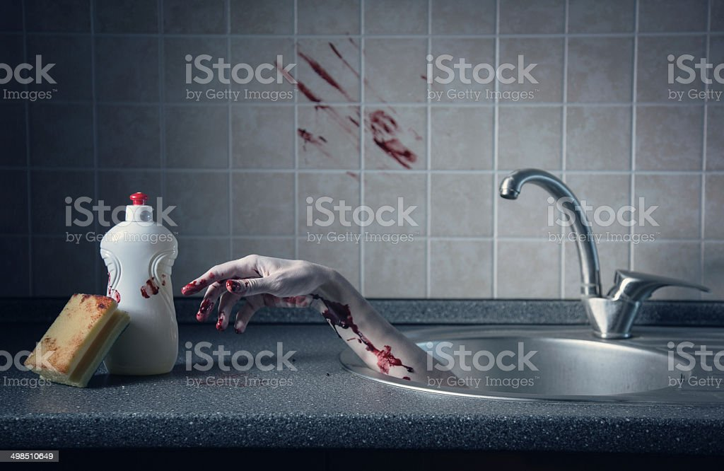 Bloody hand in kitchen sink, crime scene stock photo