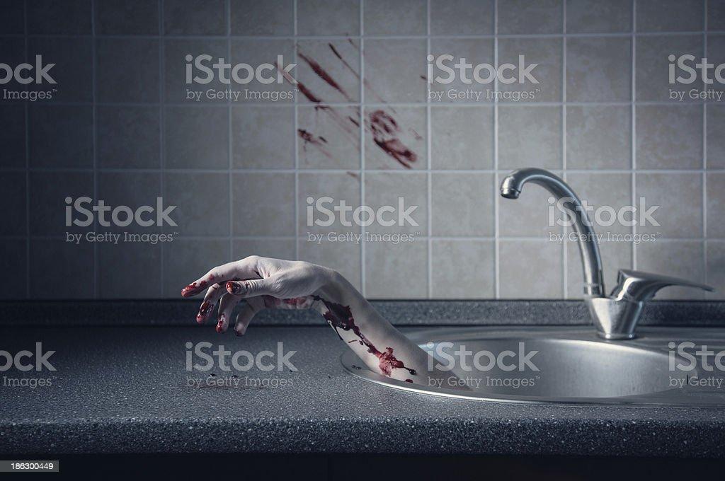 Bloody hand in kitchen sink stock photo