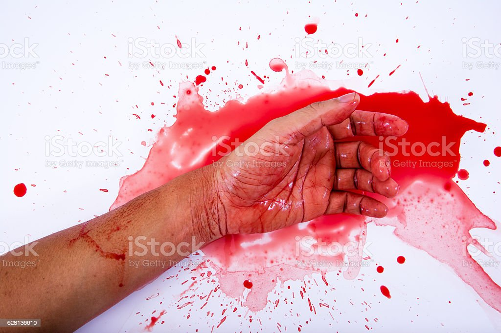 Bloody hand is smearing red blood on white background. stock photo