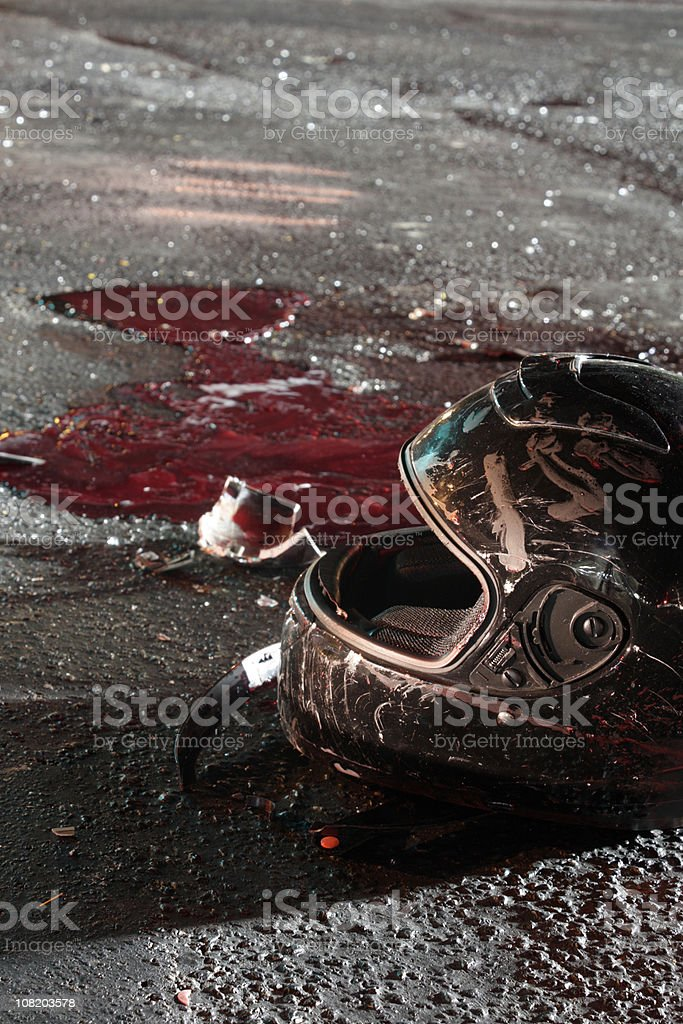 Bloody Helmet on Pavement after Crash royalty-free stock photo