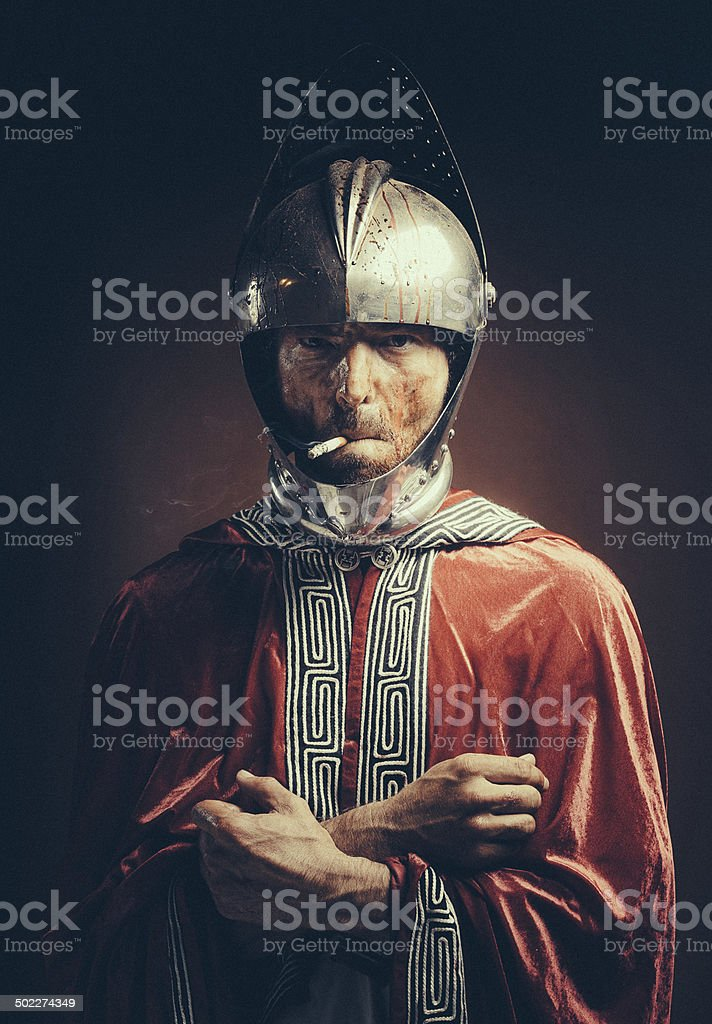 bloody knight having a cigarette stock photo
