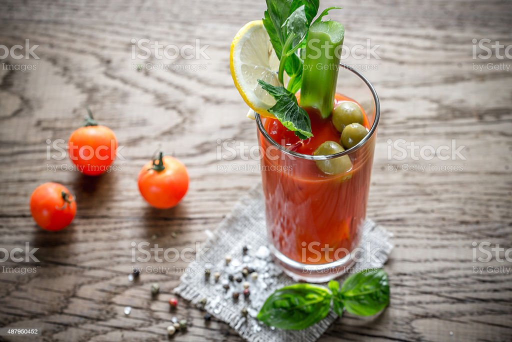 Bloody Mary cocktail on the wooden background stock photo