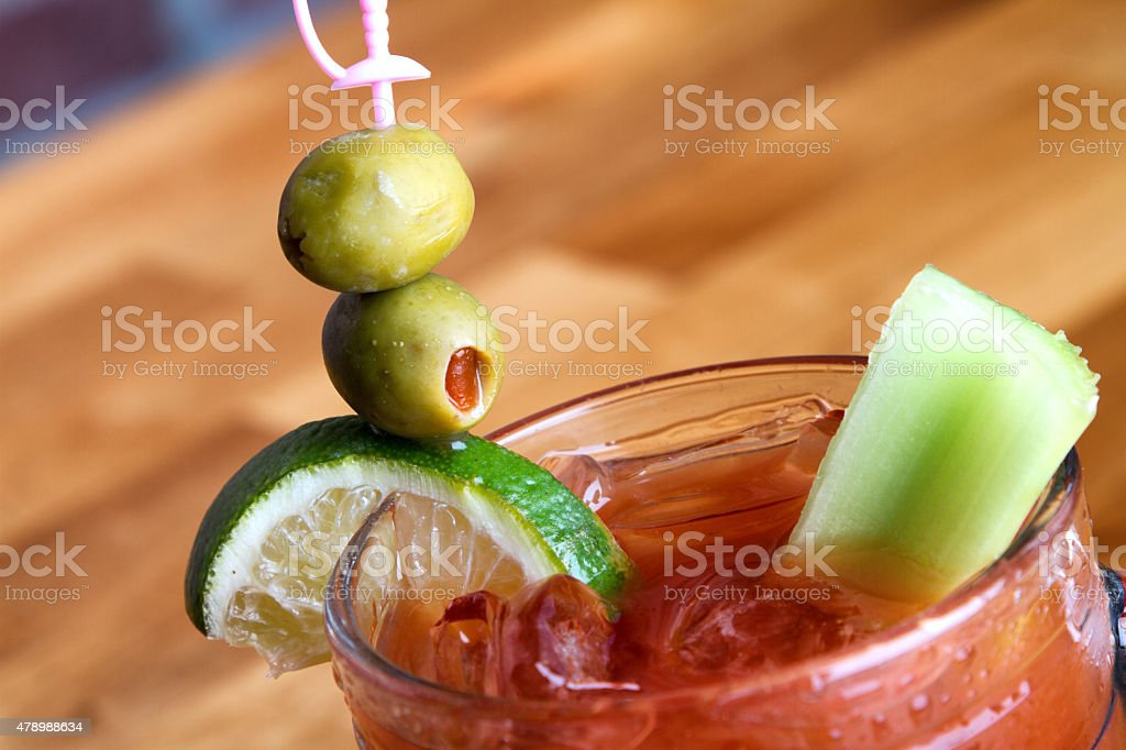 Bloody Mary Cocktail with Celery, Lime and Olives stock photo