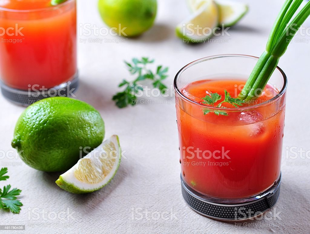 Bloody Mary cocktail with celery, pepper, sea salt stock photo