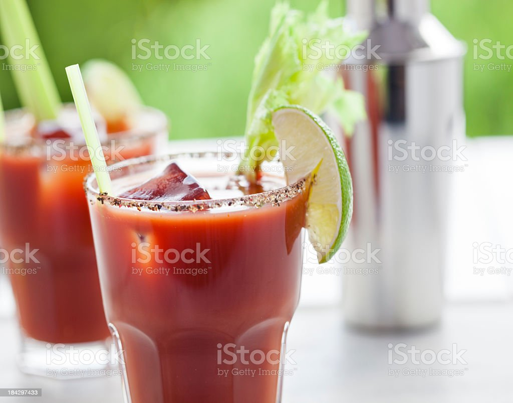 Bloody Mary or Caesar Cocktail  with Lime, Celery  and ice stock photo