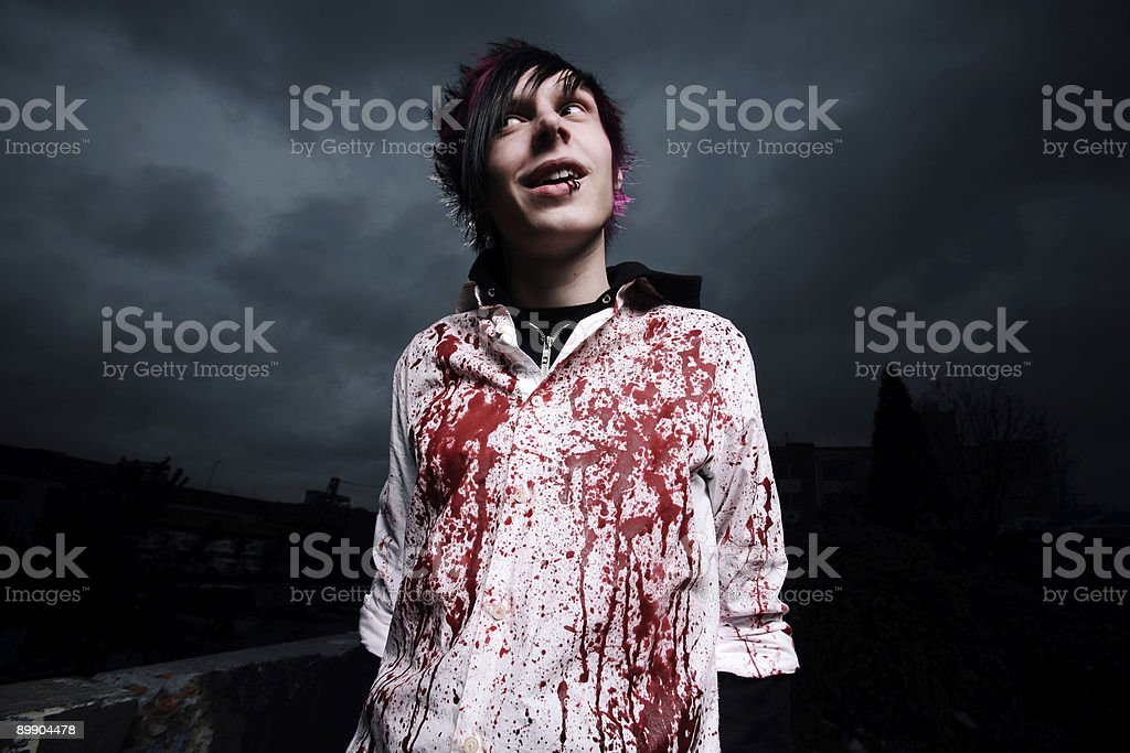 Bloody Shirt Male Portrait Against Dark Sky royalty-free stock photo