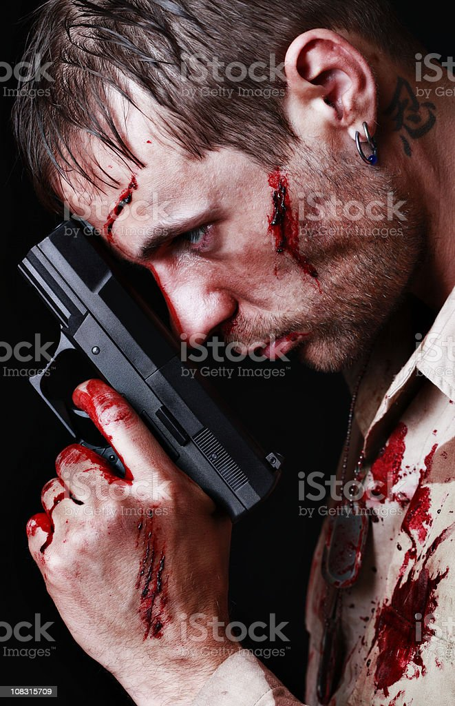 Bloody Soldier Holding Gun stock photo