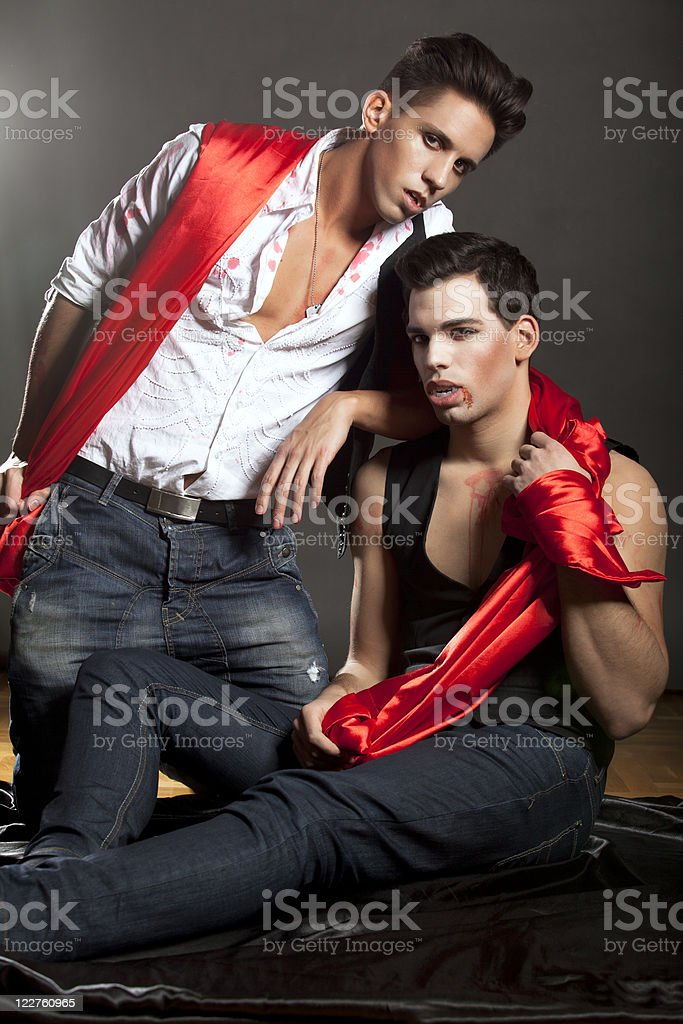 Bloody vampires posing in studio stock photo