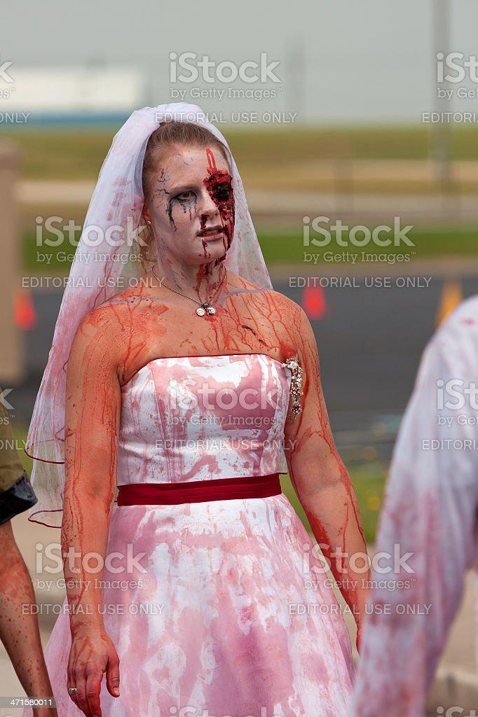 Bloody Zombie Bride Walks In 5K Race stock photo