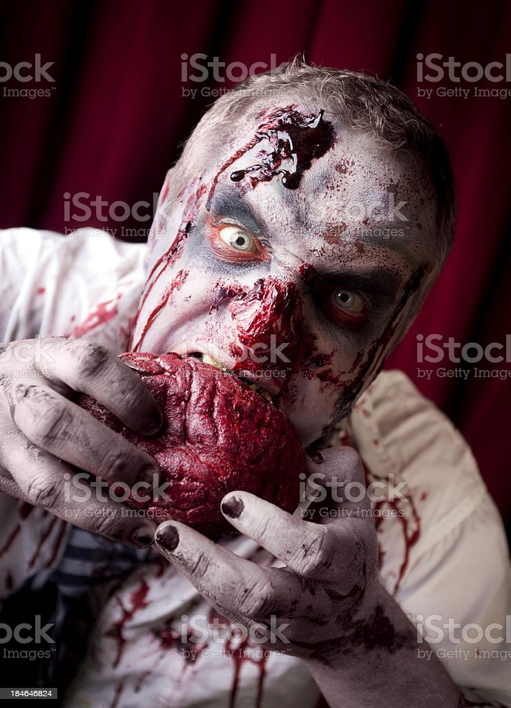Bloody Zombie Eating Brains royalty-free stock photo