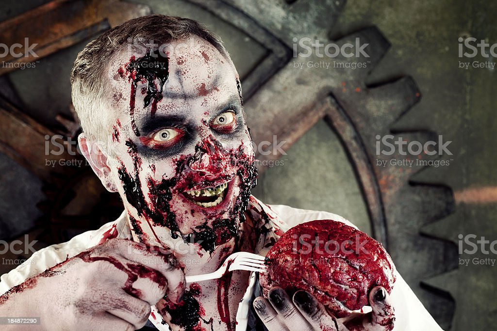 Bloody Zombie Eating Brains stock photo