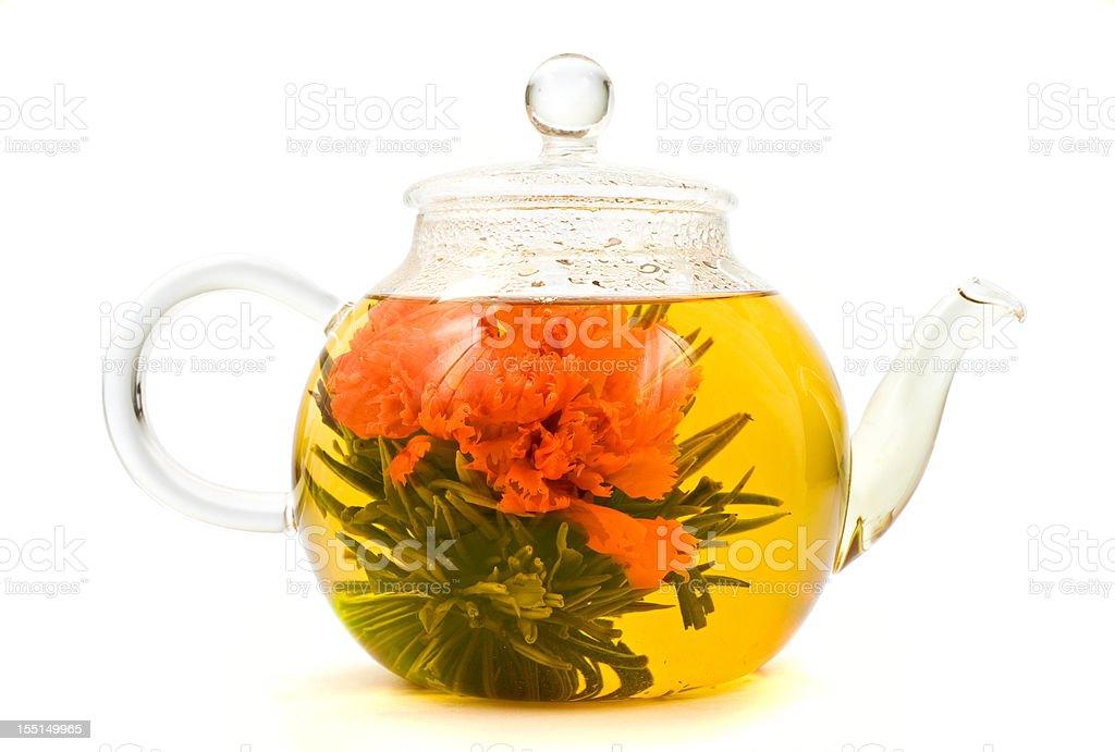 Blooming, Flowering Tea in Glass Teapot stock photo