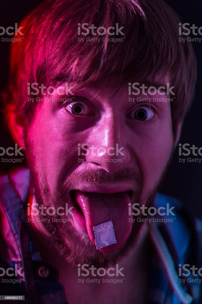 LSD blotter on the tongue stock photo