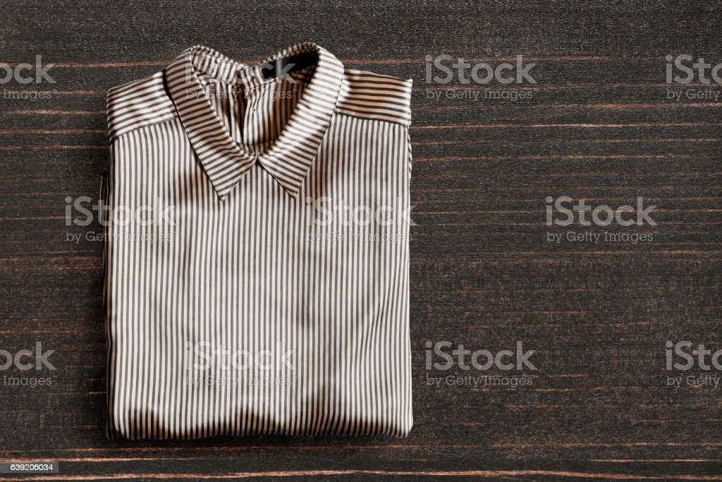 Blouse on wooden background stock photo